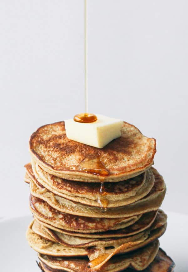 a stack of healthy pancakes with butter and maple syrup