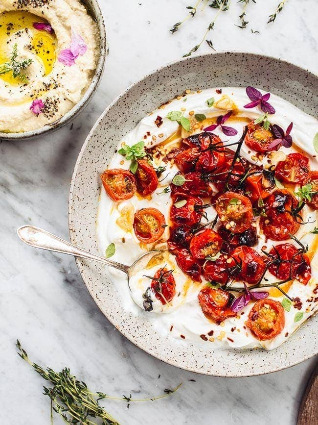 Food blogger Izy Hossack makes Ottolenghi's Hot charred tomatoes with cold yoghurt