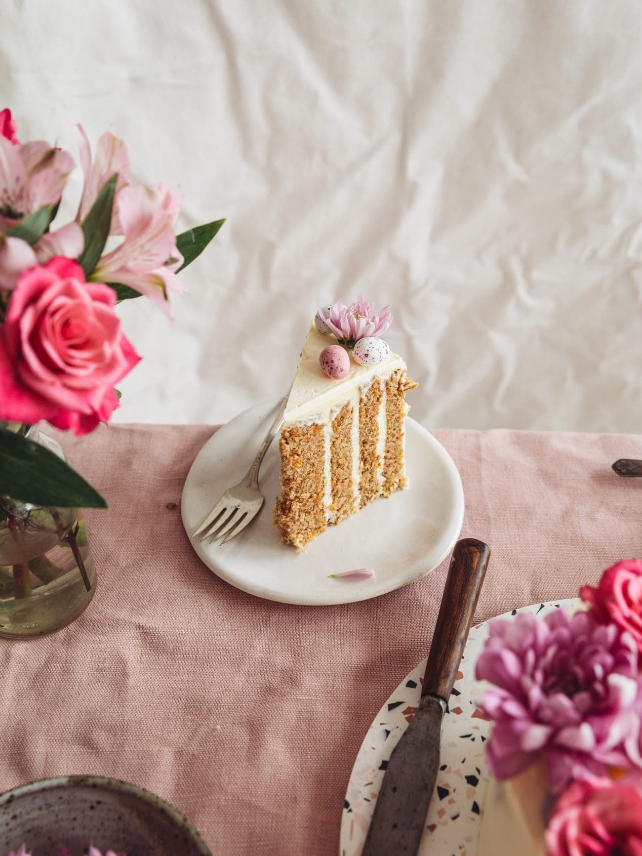 A slice of Vertical Layer Carrot Cake with vanilla Swiss Meringue Buttercream by Izy Hossack