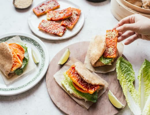 Assembling Bao buns filled with crispy gochujang tofu, lettuce and butternut squash