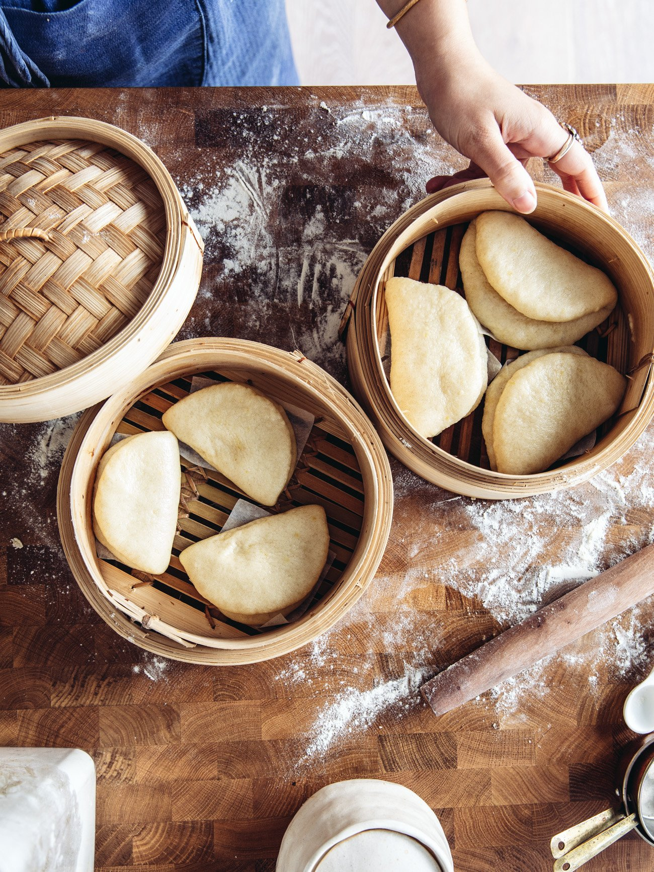 Steamed gua bao buns in a bamboo steamer