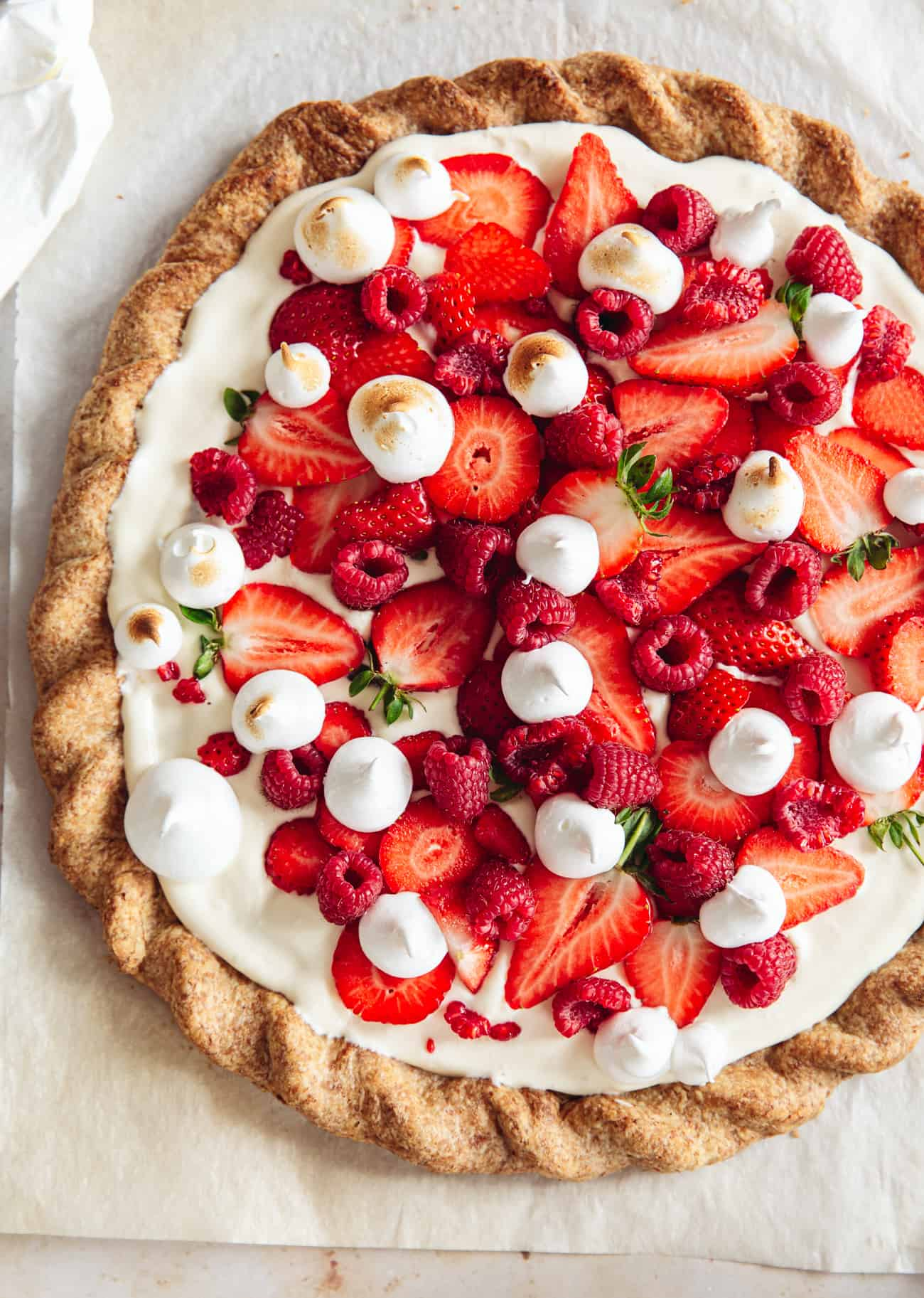 Eton mess tart with strawberries, raspberries and torched meringue