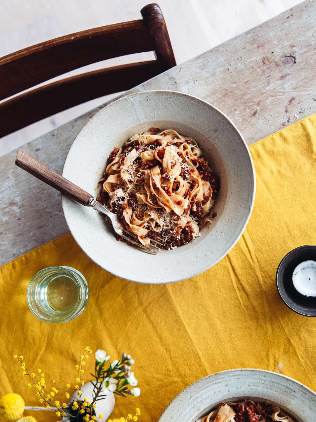 A bowl of tagliatelle with lentil ragu on a table