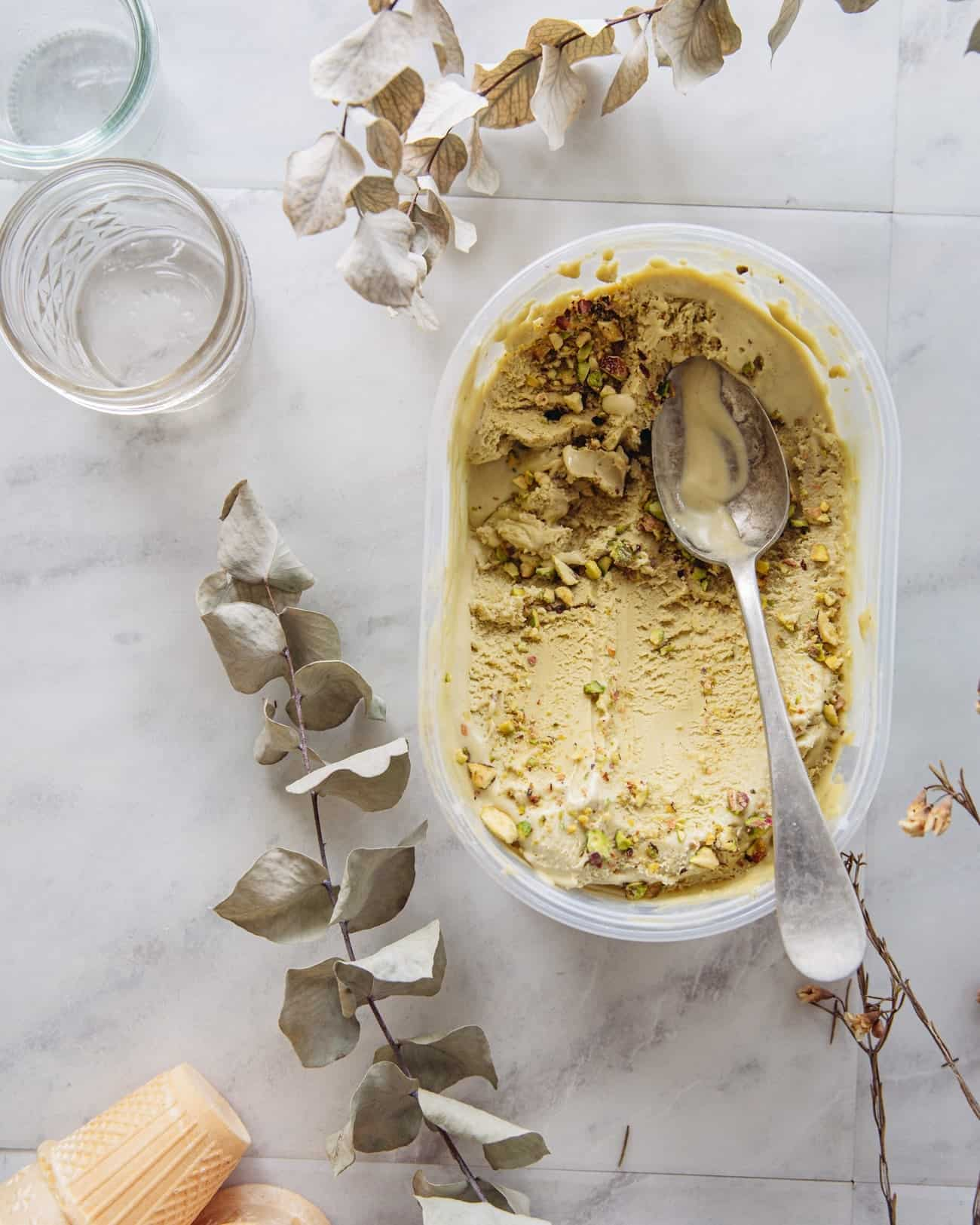 a tub of pistachio ice cream with a spoon