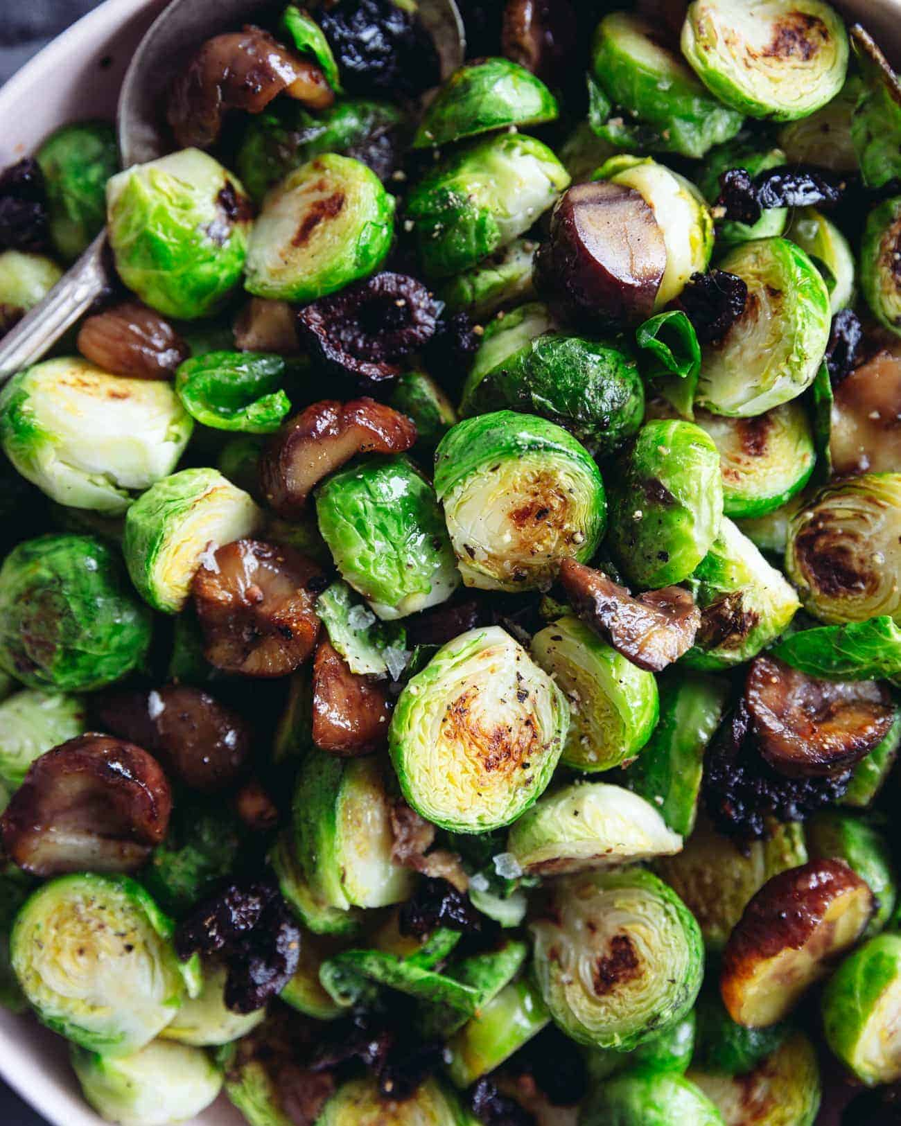 Close up of pan roasted Brussels Sprouts with chestnuts and smoky olives