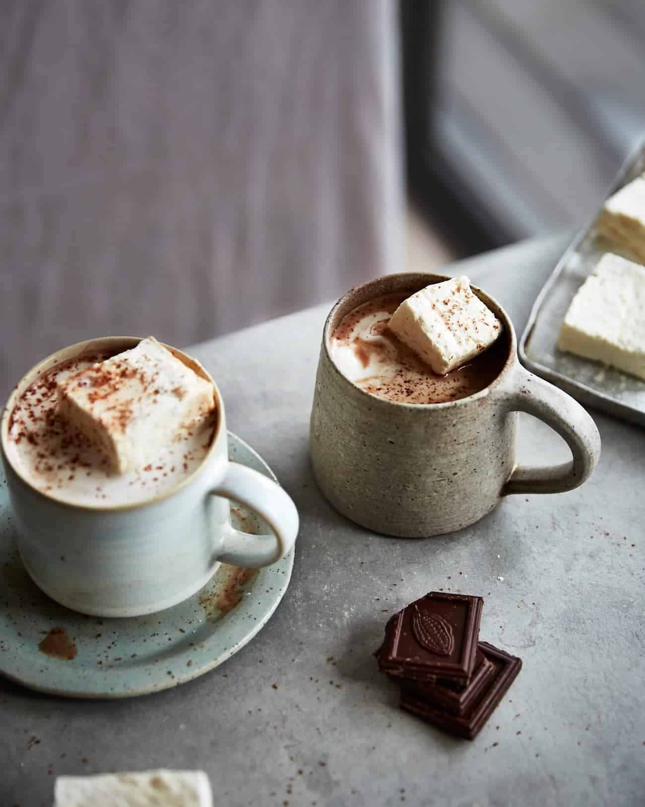 two mugs of hot chocolate with vegan marshmallows