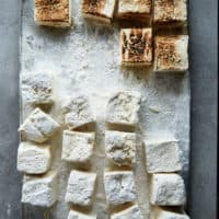 a tray of vegan marshmallows with some toasted