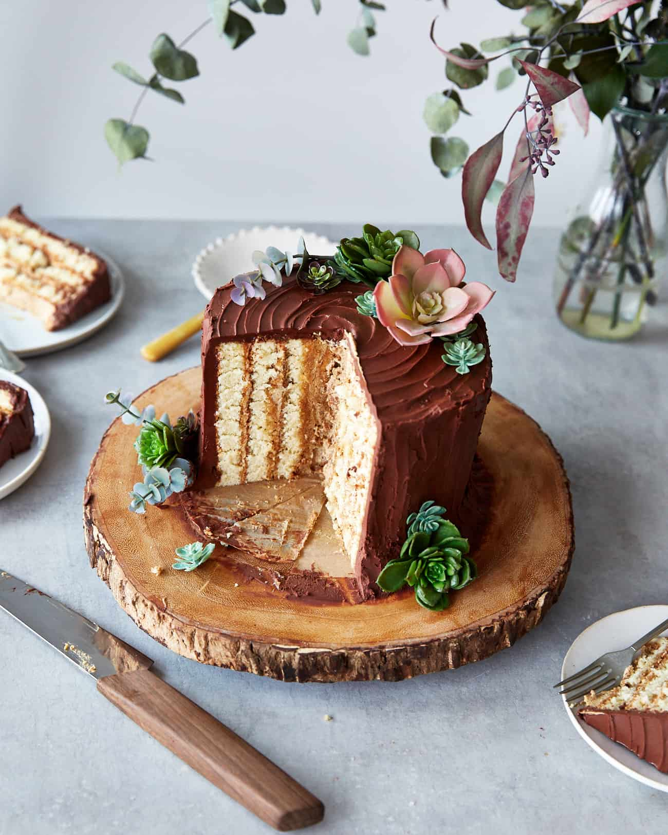 a vertical layer chocolate yule log decorated as a tree stump