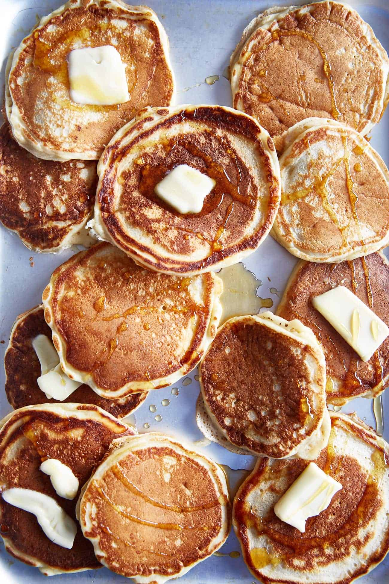 a tray of American style buttermilk pancakes with butter  & maple syrup