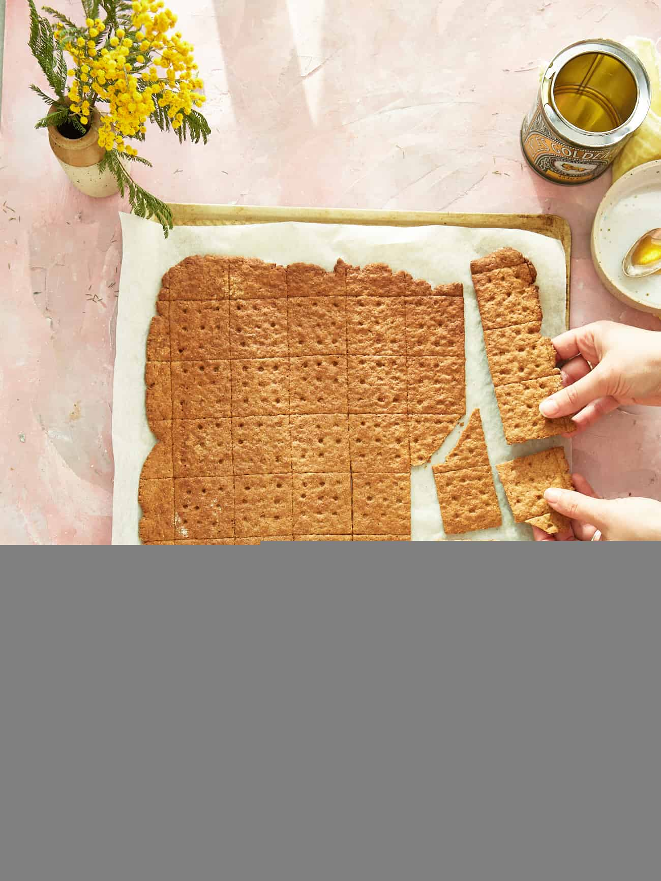 snapping a large homemade graham cracker sheet into smaller crackers