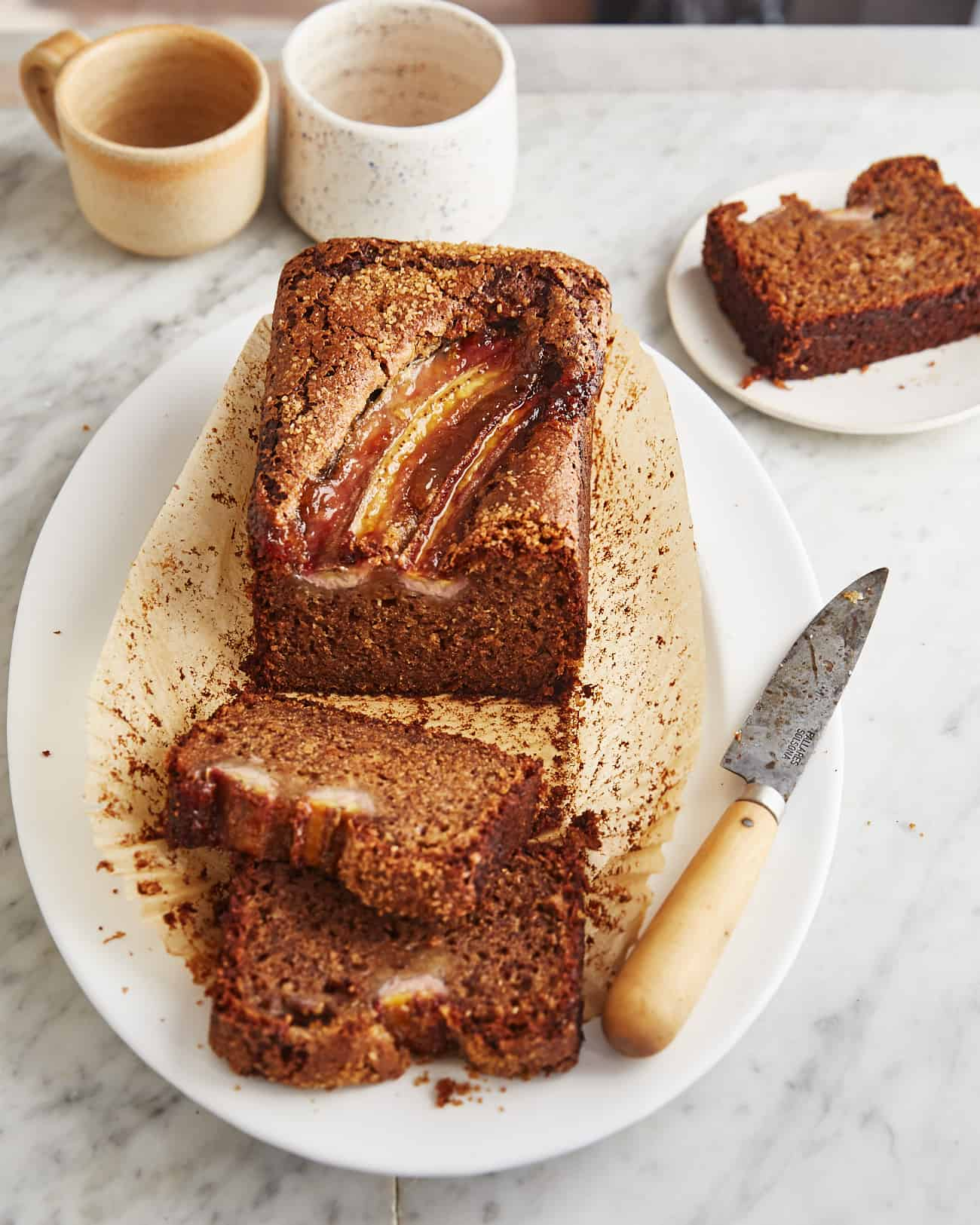 a few slices and a loaf of vegan sourdough banana bread
