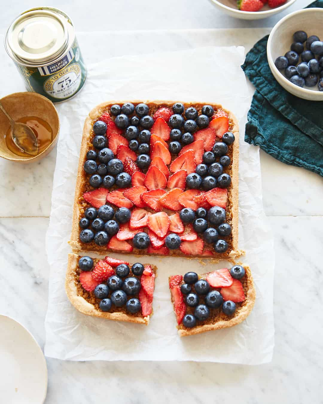a treacle tart topped with berries in the shape of the union jack