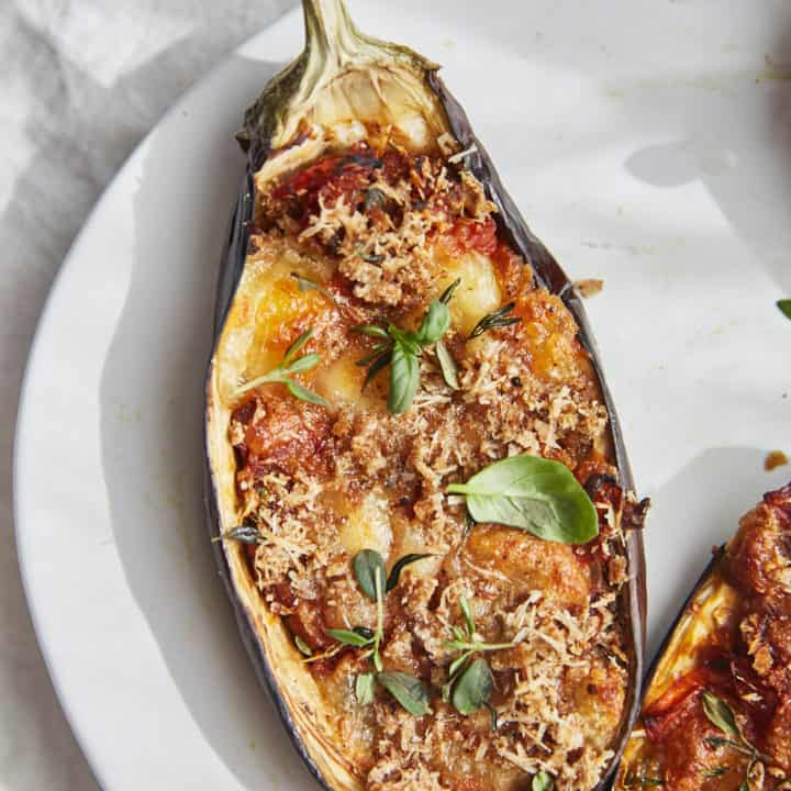 stuffed aubergine half with mozzarella, tomato and basil