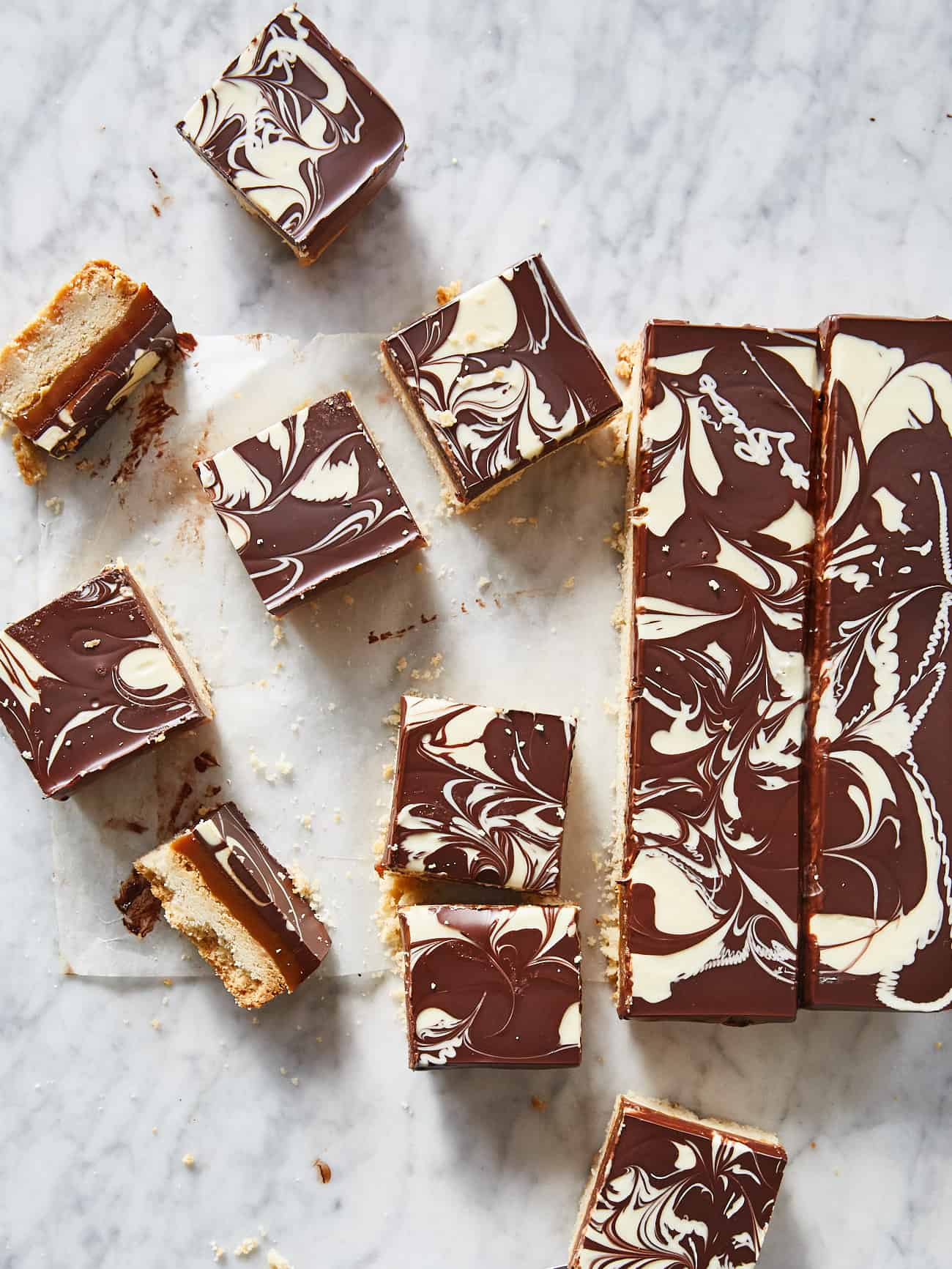 overhead shot of squares of millionaire's shortbread with marbled chocolate