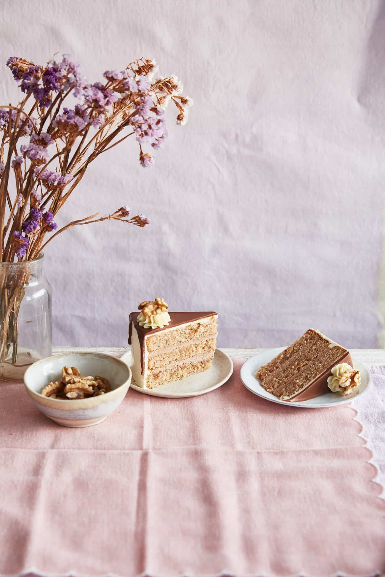 2 slices of walnut whip cake on pink cloth