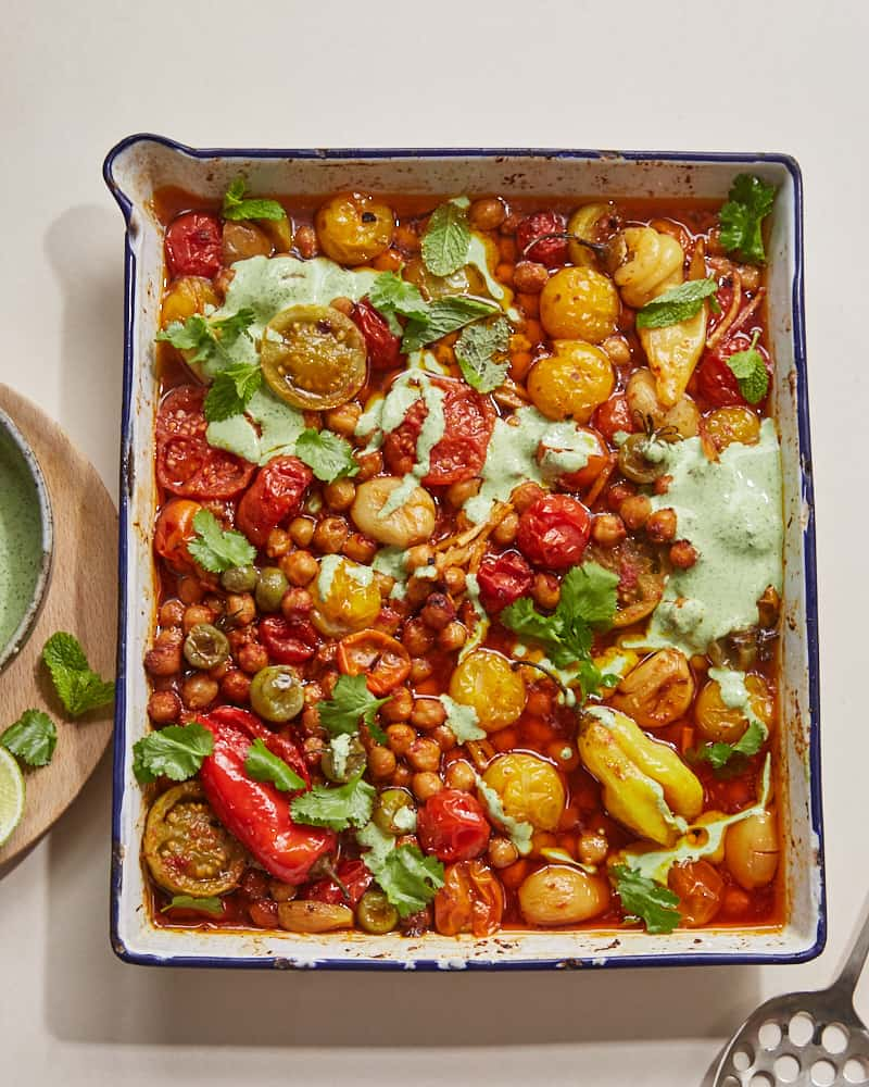 confit tandoori chickpeas drizzled with herbed yoghurt in a roasting tray